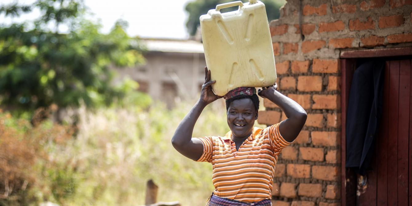 Alur Florence fetches water while her husband does other chores at home